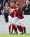 Linlithgow's Tommy Coyne (centre) celebrates after he scores their winning second goal.