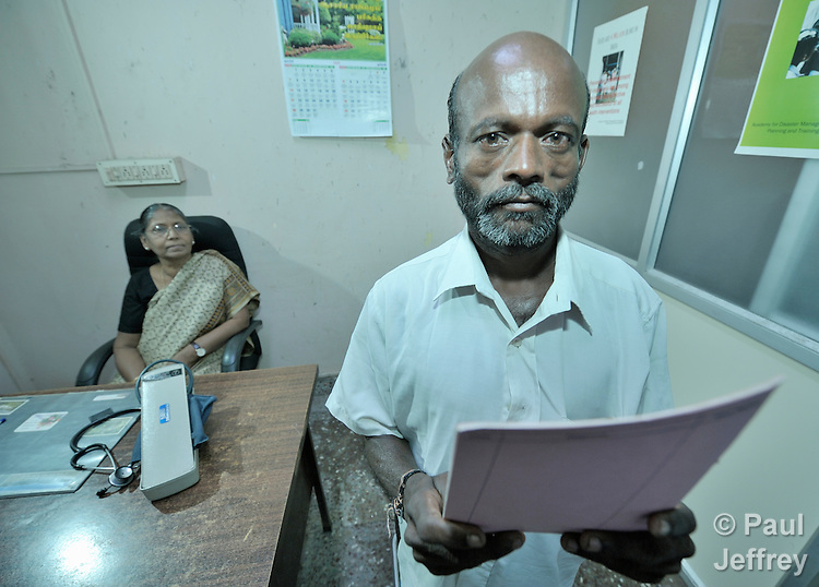 M. Palanivel pauses after being examined by Dr. Percy Sumithran at the Lutheran Church-sponsored Gurukul Clinic in Chennai, India. The patient is HIV positive and comes to the clinic because it offers specialized care for people living with HIV and AIDS.