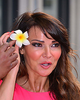 Lizzie Cundy<br /> The &quot;Bula Quo!&quot; UK film premiere, Odeon West End cinema, Leicester Square, London, England.<br /> July 1st, 2013<br /> headshot portrait pink flower in hair mouth open <br /> CAP/BF<br /> &copy;Bob Fidgeon/Capital Pictures