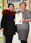 Bridie Clarke accepts her certificate for Adult Short Stories, from Mona Daly..Picture: Shane Maguire / www.newsfile.ie.
