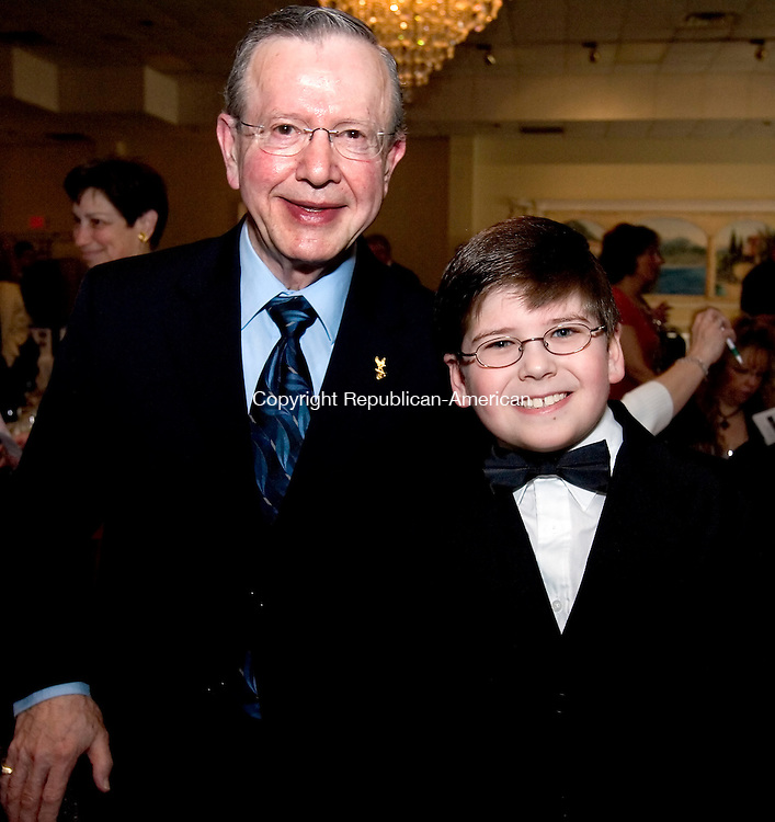 WATERTOWN, CT--21 APRIL 2007--042107JS04-Rudy Mazurosky of Woodbury with his grandson William Linster, 10, of Woodbury at the NVCC Foundation's third annual mystery dinner theater fundraiser at the Grand Oak Villa in Watertown. <br /> Jim Shannon / Republican-American