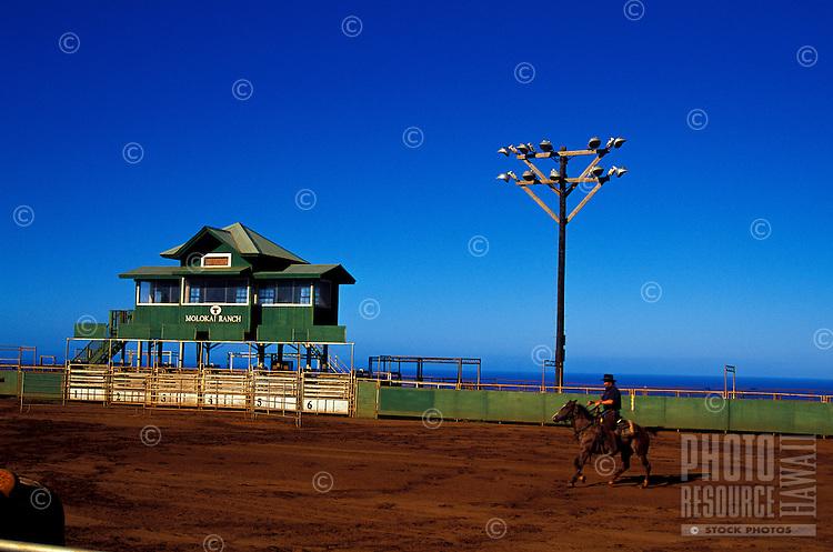 The Paniolo Rodeo Arena with a man riding a horse on Molokai Ranch
