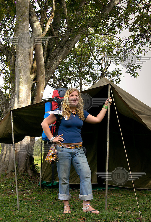 Nineteen year old British backpacker, Celia Keek, poses for a photograph outside her tent at the 'Nairobi Backpackers' hostel..