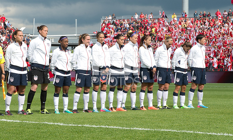 02 June 2013: The U.S. Women's National Team participates in the national anthems and opening ceremonies during an International Friendly soccer match between the U.S. Women's National Soccer Team and the Canadian Women's National Soccer Team at BMO Field in Toronto, Ontario.<br /> The U.S. Women's National Team Won 3-0.