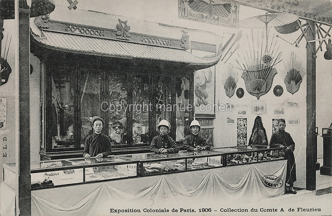 Indochina section with indigenous people and artefacts on display, at the Colonial Exhibition in Paris, July - November 1906, held at the Grand Palais on the Champs-Elysees, postcard from the Musee de Nogent sur Marne, Eastern Paris, France. Colonial Exhibitions were designed to increase trade with and investment in, French Overseas Territories. Picture by Manuel Cohen / Musee de Nogent sur Marne