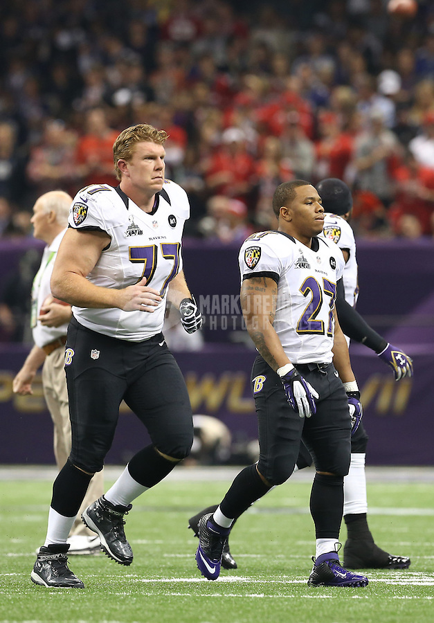 Feb 3, 2013; New Orleans, LA, USA; Baltimore Ravens center Matt Birk (77) and running back Ray Rice (27) against the San Francisco 49ers in Super Bowl XLVII at the Mercedes-Benz Superdome. Mandatory Credit: Mark J. Rebilas-