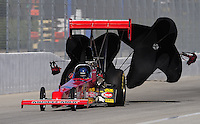 Nov 13, 2010; Pomona, CA, USA; NHRA top fuel dragster driver Ron August during qualifying for the Auto Club Finals at Auto Club Raceway at Pomona. Mandatory Credit: Mark J. Rebilas-