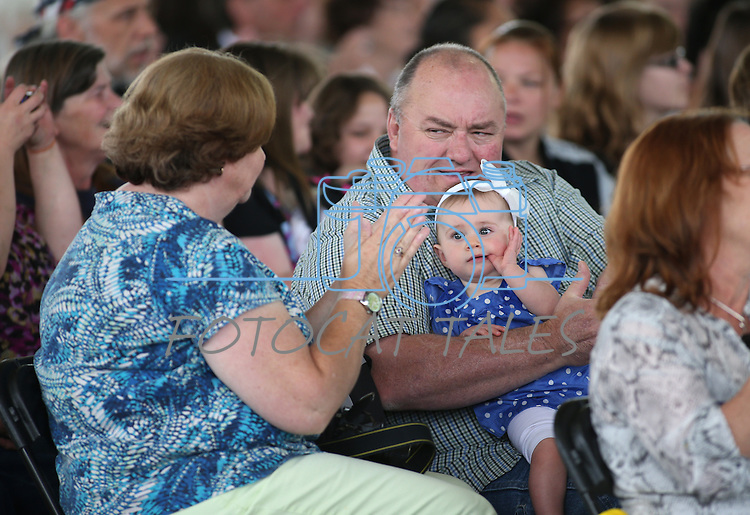 Connie and Scott Etchison and their granddaughter Emma Jo, 9 months, wait for her uncle to graduate in the Western Nevada College commencement at the Pony Express Pavilion, in Carson City, Nev., on Monday, May 19, 2014. <br /> Photo by Cathleen Allison/Nevada Photo Source
