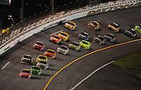 Jul. 5, 2008; Daytona Beach, FL, USA; NASCAR Sprint Cup Series driver Jeff Gordon (24) leads the field during the Coke Zero 400 at Daytona International Speedway. Mandatory Credit: Mark J. Rebilas-