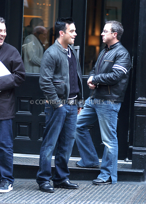 "British singer Robbie Williams spends some leasure time with his friends in Soho. Robbie was seen enjoying his cigarette and sharing a few laughs with his companions. Robbie is in town to participate in ""100% NYC"" concert which celebrates 2nd Annual Tribeca Film Festival."" New York, May 8, 2003...Please byline: Philip Vaughan/NY Photo Press.   ..*PAY-PER-USE*      ....NY Photo Press:  ..phone (646) 267-6913;   ..e-mail: info@nyphotopress.com"