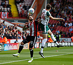 Kieron Freeman of Sheffield Utd tussles with Ryan Hedges of Barnsley during the Championship League match at Bramall Lane Stadium, Sheffield. Picture date 19th August 2017. Picture credit should read: Simon Bellis/Sportimage