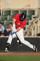 Mason Robbins (10) of the Kannapolis Intimidators makes contact with the baseball against the Greensboro Grasshoppers at CMC-Northeast Stadium on August 1, 2015 in Kannapolis, North Carolina.  The Intimidators defeated the Grasshoppers 7-4.  (Brian Westerholt/Four Seam Images)