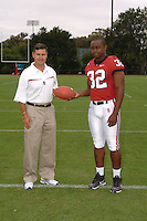 7 August 2006: Stanford Cardinal head coach Walt Harris and Emeka Nnoli during Stanford Football's Team Photo Day at Stanford Football's Practice Field in Stanford, CA.