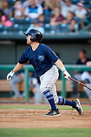 Mobile BayBears right fielder Zach Gibbons (14) follows through on a swing during a game against the Jacksonville Jumbo Shrimp on April 14, 2018 at Baseball Grounds of Jacksonville in Jacksonville, Florida.  Mobile defeated Jacksonville 13-3.  (Mike Janes/Four Seam Images)