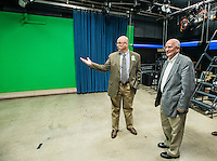 STAFF PHOTO ANTHONY REYES &bull; @NWATONYR<br /> Fritz Gisler, left, director fo media services for Fayetteville, talks with John La Tour, incoming Fayetteville alderman, inside a television studio Monday Dec. 29, 2014 during a tour of the Fayetteville Television Center in Fayetteville. La Tour was touring several city owned sites to learn more of what the city offers to citizens including Water &amp; Sewer offices, Fayetteville Animal Shelter, Transportation and Fleet divisions among other sites and offices.