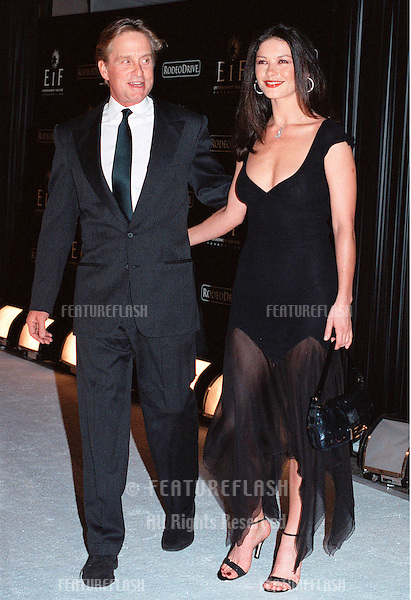 "07NOV99: Actress CATHERINE ZETA-JONES & actor boyfriend MICHAEL DOUGLAS at Beverly Hills' Rodeo Drive's ""Tribute to Style: Millennium Exhibition & Concert"" in aid of the Entertainment Industry Foundation.                          © Paul Smith / Featureflash"