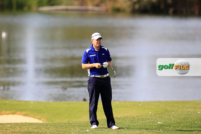 Richie Ramsay (SCO) waits to play his 2nd shot on the 14th hole during Sunday's Final Round of the 2013 Portugal Masters held at the Oceanico Victoria Golf Club. 13th October 2013.<br /> Picture: Eoin Clarke/www.golffile.ie