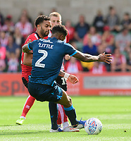 Lincoln City's Bruno Andrade is fouled by Bristol Rovers' Mark Little<br /> <br /> Photographer Chris Vaughan/CameraSport<br /> <br /> The EFL Sky Bet League One - Lincoln City v Bristol Rovers - Saturday 14th September 2019 - Sincil Bank - Lincoln<br /> <br /> World Copyright © 2019 CameraSport. All rights reserved. 43 Linden Ave. Countesthorpe. Leicester. England. LE8 5PG - Tel: +44 (0) 116 277 4147 - admin@camerasport.com - www.camerasport.com