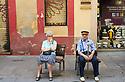 Men sitting on street  in  the City of Barcelona in Catalunya in Spain in Europe