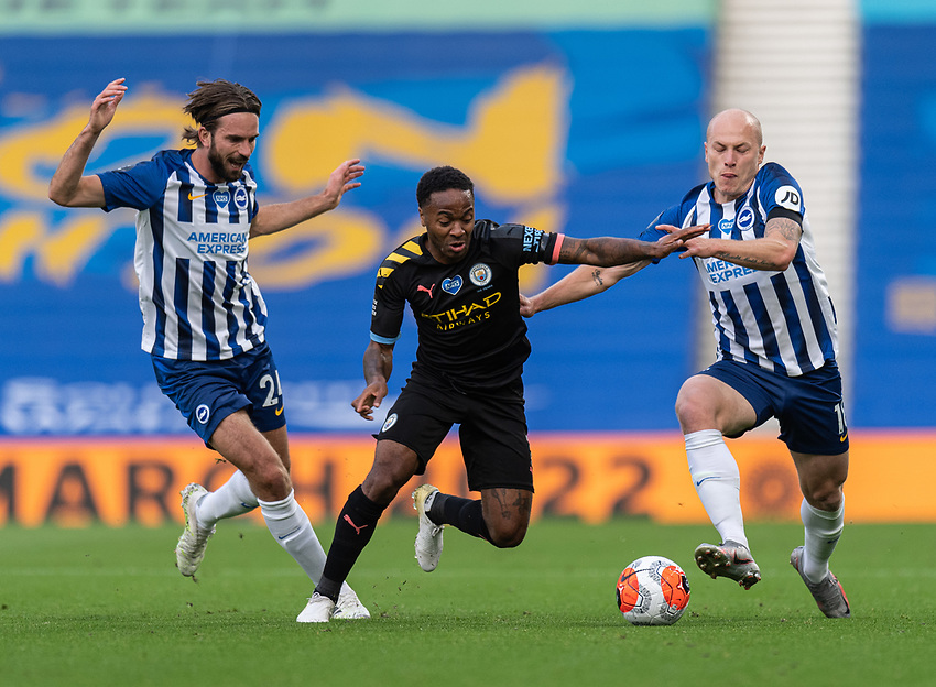 Manchester City's Raheem Sterling (centre) under pressure from Brighton & Hove Albion's Davy Propper (left) and Aaron Mooy (right) <br /> <br /> Photographer David Horton/CameraSport<br /> <br /> The Premier League - Brighton & Hove Albion v Manchester City - Saturday 11th July 2020 - The Amex Stadium - Brighton<br /> <br /> World Copyright © 2020 CameraSport. All rights reserved. 43 Linden Ave. Countesthorpe. Leicester. England. LE8 5PG - Tel: +44 (0) 116 277 4147 - admin@camerasport.com - www.camerasport.com