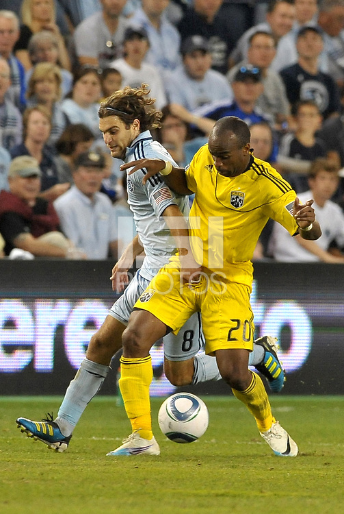 Emilio Renteria (20) forward Columbus Crew fights for the ball with Graham Zusi (8) Sporting KC... Sporting Kansas City defeated Columbus Crew 2-1 at LIVESTRONG Sporting Park, Kansas City, Kansas.