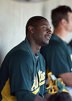Chris Carter #22 of the Oakland Athletics watches his teammates against the Cleveland Indians in a spring training game at Phoenix Municipal Stadium on March 2, 2011  in Phoenix, Arizona. .Photo by:  Bill Mitchell/Four Seam Images.
