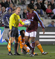 Colorado defender Corey Gibbs and Houston forward Brian Ching (sitting) exchange a few words. The Houston Dynamo defeated the Colorado Rapids 3-1 at Dick's Sporting Goods Park, Denver, Colorado. Saturday, October 4, 2008. Photo by Trent Davol/isiphotos.com.