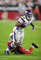 Dec 6, 2009; Glendale, AZ, USA; Minnesota Vikings running back (29) Adrian Peterson is tackled by Arizona Cardinals cornerback (29) Dominique Rodgers-Cromartie at University of Phoenix Stadium. The Cardinals defeated the Vikings 30-17. Mandatory Credit: Mark J. Rebilas-