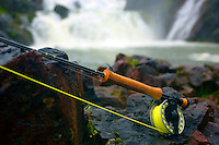 Atlantic Salmon Catch and Release Fly Fishing in Iceland. Fly rod and a fly with Storifoss pool in Svalbardsa river in the background.