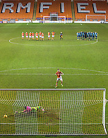 Goalkeeper Jamal Blackman of Wycombe Wanderers saves the final penalty from Will Aimson of Blackpool to send his team through in front of an near empty stadium during the The Checkatrade Trophy match between Blackpool and Wycombe Wanderers at Bloomfield Road, Blackpool, England on 10 January 2017. Photo by Andy Rowland / PRiME Media Images.