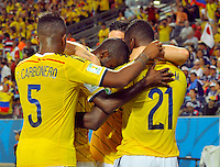 CUIABA - BRASIL -24-06-2014. Jugadores de Colombia (COL) celebran un gol de Jackson Martinez (#21) anotado a Japón (JPN) durante partido del Grupo C de la Copa Mundial de la FIFA Brasil 2014 jugado en el estadio Arena Pantanal de Cuiaba./ Players of Colombia (COL) celebrate a goal from Jackson Martinez (#21) scored to Japan (JPN) during the macth of the Group C of the 2014 FIFA World Cup Brazil played at Arena Pantanal stadium in Cuiaba. Photo: VizzorImage / Alfredo Gutiérrez / Contribuidor