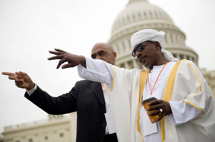 Iman Ali Jaaber of Elizabeth, N.J., right, talks with Ahmed Burhani, also of New Jersey, during the Islam on Capitol Hill prayer event on the West Lawn of the Capitol, Sept. 25, 2009.