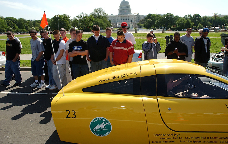 cars2/051403 - High school kids from Charles County Career and Tech in Marylad, check out the Viking 23, a hybrid car powered by biodiesel fuel and eletrcity, from Western Washington University in Washington state.   The Drive to Survive, a two week drive from L.A. to D.C., arrived on the mall, Tuesday, featuring cutting edge vehicles such as those powered by hydrogen, electricity, compressed natural gas, biodeisel, ethenol, methenol and solar energy.  Thousands of petitions will also be delivered to members of Congress to make a declaration of energy independence by increasign fuel efficiency, promoting alternative energy and decreasing our dependence on foreign oil.