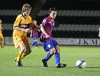 David Ferguson closes down Anton Brady in the St Mirren v Motherwell Clydesdale Bank Scottish Premier League U20 match played at St Mirren Park, Paisley on 10.9.12..