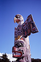 Kwakwaka'wakw (Kwakiutl) Memorial Totem Pole, on Namgis Burial Grounds, Alert Bay, Cormorant Island, BC, British Columbia, Canada - Thunderbird sits atop Grizzly Bear