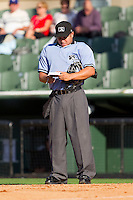 Home plate umpire Ivan Mercado checks his lineup cards during the South Atlantic League game between the Hickory Crawdads and the Kannapolis Intimidators at Fieldcrest Cannon Stadium on April 17, 2011 in Kannapolis, North Carolina.   Photo by Brian Westerholt / Four Seam Images