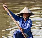 Vietnamese Boatwoman 02 - Vietnamese boat woman in a small boat on the Thu Bon River, Hoi An, Viet Nam