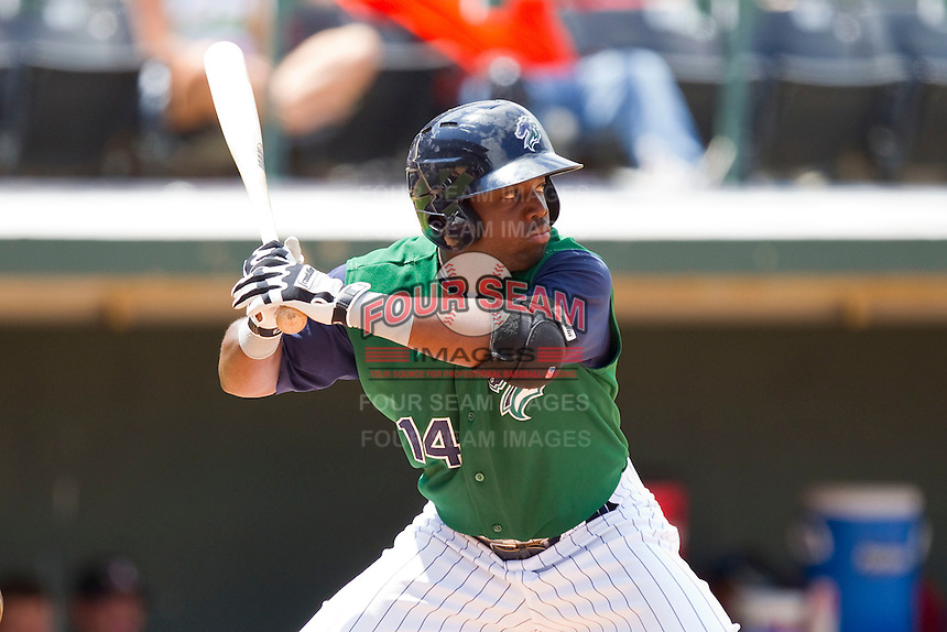Lastings Milledge #14 of the Charlotte Knights at bat against the Louisville Bats at Knights Stadium on July 17, 2011 in Fort Mill, South Carolina.  The Knights defeated the Bats 7-6.   (Brian Westerholt / Four Seam Images)