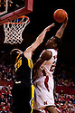 29 February 2012: Caleb Walker #25 of the Nebraska Cornhuskers slam dunks the ball against Eric May #25 of the Iowa Hawkeyes during the second half at the Devaney Sports Center in Lincoln, Nebraska. Iowa defeated Nebraska 62 to 53.