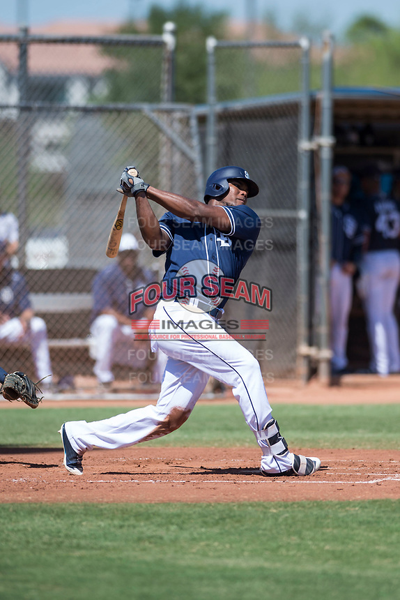 San Diego Padres center fielder Franchy Cordero (22) follows through on his swing during a rehab assignment in an Instructional League game against the Milwaukee Brewers at Peoria Sports Complex on September 21, 2018 in Peoria, Arizona. (Zachary Lucy/Four Seam Images)