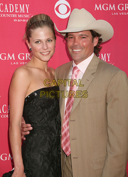 JESSICA CRAIG & CLAY WALKER.42nd Annual Academy Of Country Music Awards held at the MGM Grand Garden Arena, Las Vegas, Nevada, USA..May 15th, 2007.half length black fiancee strapless dress beige suit jacket stetson .CAP/ADM/BP.©Byron Purvis/AdMedia/Capital Pictures