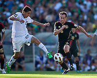 PASADENA, CA – June 25, 2011: USA player Alejandro Bedoya (22) and Mexico player Gerardo Torrado (6) during the Gold Cup Final match between USA and Mexico at the Rose Bowl in Pasadena, California. Final score USA 2 and Mexico 4.