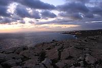 Beautiful sunset sky and rocks at Ayia Napa beach of Cyprus.