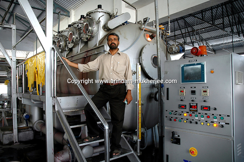 General Manager Mr. Prakah of Prem Textiles one of the biggest in the Town standing in front of an Indian made comuterised Dyeing machine at his factory in Tirupur, Tamilnadu. After lifting of quota system in textile export on 1st january 2005. Tirupur has become the biggest foreign currency earning town of India.