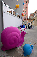Una veduta del nuovo centro commerciale Happio nel quartiere di San Giovanni, con le lumache giganti in plastica riciclata, parte di un'installazione di Cracking art in occasione della sua inaugurazione, a Roma, 26 marzo 2015.<br /> A view of the new commercial center Happio, with recycled plastic giant snails part of a Cracking Art installation in Rome, 26 March 2015.<br /> UPDATE IMAGES PRESS/Riccardo De Luca