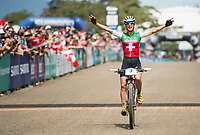 Picture by Alex Broadway/SWpix.com - 09/09/17 - Cycling - UCI 2017 Mountain Bike World Championships - XCO - Cairns, Australia - Jolanda Neff of Switzerland celebrates as she crosses the line to win the Women's Elite Cross Country Final.