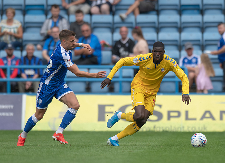 Bolton Wanderers' Yoan Zouma (right) under pressure from  Gillingham's Olly Lee (left) <br /> <br /> Photographer David Horton/CameraSport<br /> <br /> The EFL Sky Bet League One - Gillingham v Bolton Wanderers - Saturday 31st August 2019 - Priestfield Stadium - Gillingham<br /> <br /> World Copyright © 2019 CameraSport. All rights reserved. 43 Linden Ave. Countesthorpe. Leicester. England. LE8 5PG - Tel: +44 (0) 116 277 4147 - admin@camerasport.com - www.camerasport.com