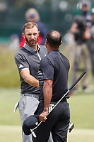 Dustin Johnson (USA) shakes hands with Tiger Woods (USA) after finishing on the 9th green during the second round of the 118th U.S. Open Championship at Shinnecock Hills Golf Club in Southampton, NY, USA. 15th June 2018.<br /> Picture: Golffile | Brian Spurlock<br /> <br /> <br /> All photo usage must carry mandatory copyright credit (&copy; Golffile | Brian Spurlock)