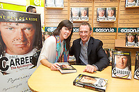 NO REPRO FEE.8/10/2011. Eason, Ireland's leading retailer of books, stationery, magazines and lots more, hosted a book signing by Jockey, Paul Carberry.  Pictured at Eason, O'Connell Street, Dublin is fan Janet Cooke from Drumcondra with Paul Carberry who signed copies of his new autobiography One Hell of a Ride. Follow Eason on Twitter - @easons For further information, please contact: Aoife McDonald WHPR 087 4100777 . Picture James Horan/Collins Photos