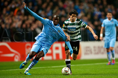 15.03.2012 Manchester, England. Manchester City's Ivory Coast midfielder Yaya Toure and Sporting Clube de Portugal Chilean midfielder Matias Fernandez in action during the UEFA Europa Cup match between Manchester City v Sporting at the Etihad Stadium.